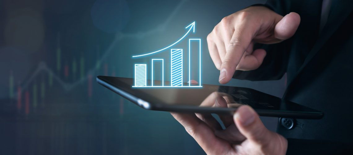 businessman-holding-tablet-and-have-a-chart-showing-business-growth-positive-indication-of-income_t20_V706G8